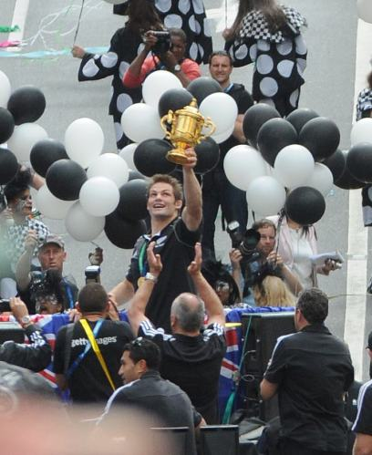 Richie McCaw, captain of the All Blacks with the Webb Ellis Cup! World Rugby Champions!